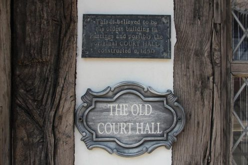 Plaque, stating The Old Court Hall is believed to be the oldest building in Hastings