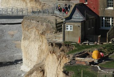 Aftermath of storms 2014, former coastguard cottage, above cliff fall, Birling Gap