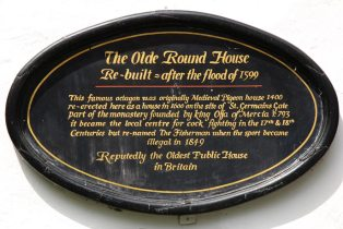 Plaque on Ye Olde Fighting Cocks, the oldest pub in Britain, St. Albans