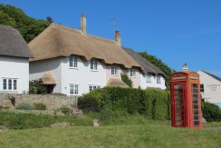 Thatched cottages and red telephone box, Lulworth Cove