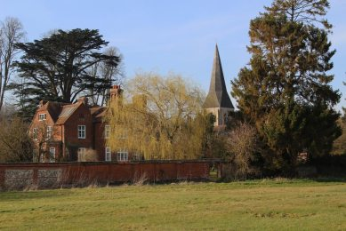 All Hallows Church, from banks of River Test, Whitchurch