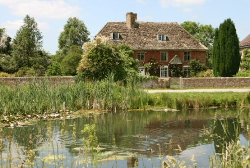 Dove Cottage and village pond, Frampton on Severn