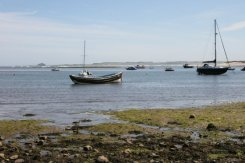 The Harbour, Holy Island, Lindisfarne, looking towards Bamburgh Castle