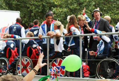 Clare Balding, Archery and Athletics float. Olympic and Paralympic Victory Parade 2012