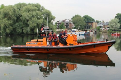 RNLI. Olympic Torch, The Gloriana, River Thames, Richmond. 27th July 2012