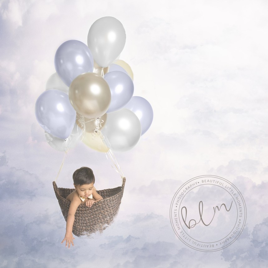 first birthday photo shoot epsom boy with balloons