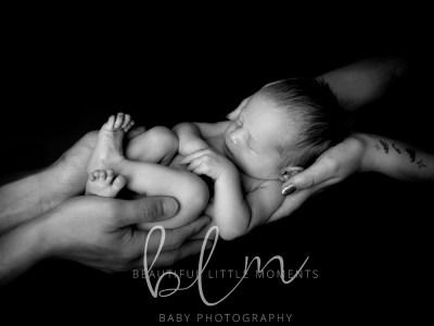 black-white-newborn-parents-hands-sq