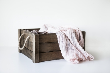 Brown crate with pink