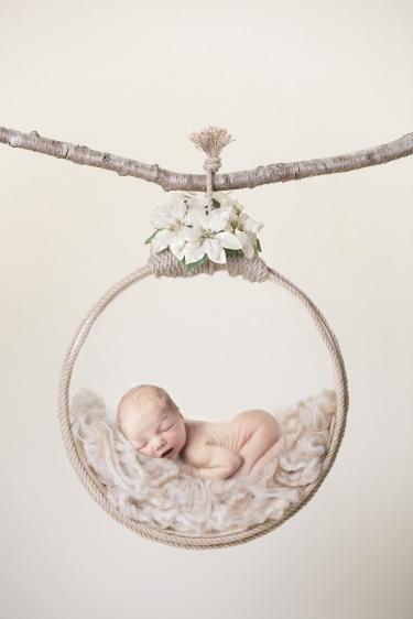 newborn baby photo baby lying in a hoop