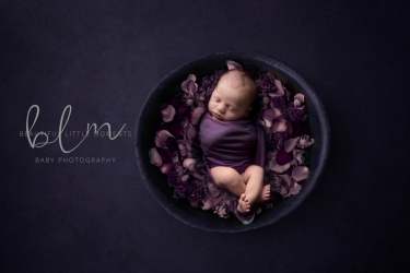 newborn-boy-purple-bowl-flowers-crop