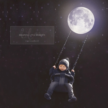 two-year-old-boy-swinging-moon