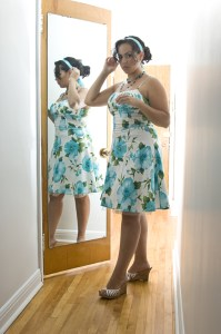 woman lacking confidence in her body looking in mirror