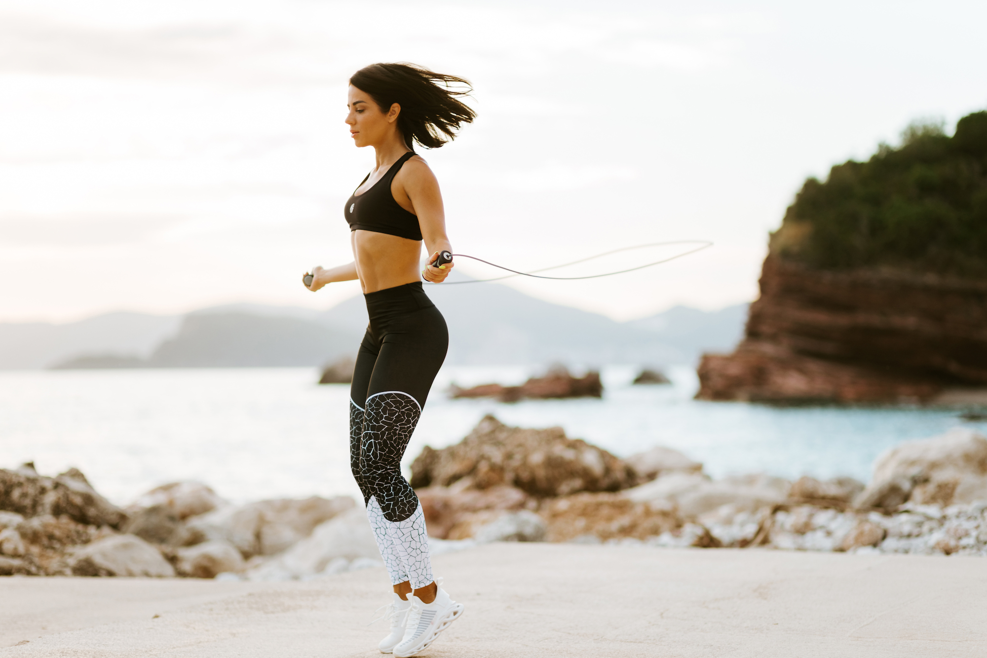 sporty woman skipping rope