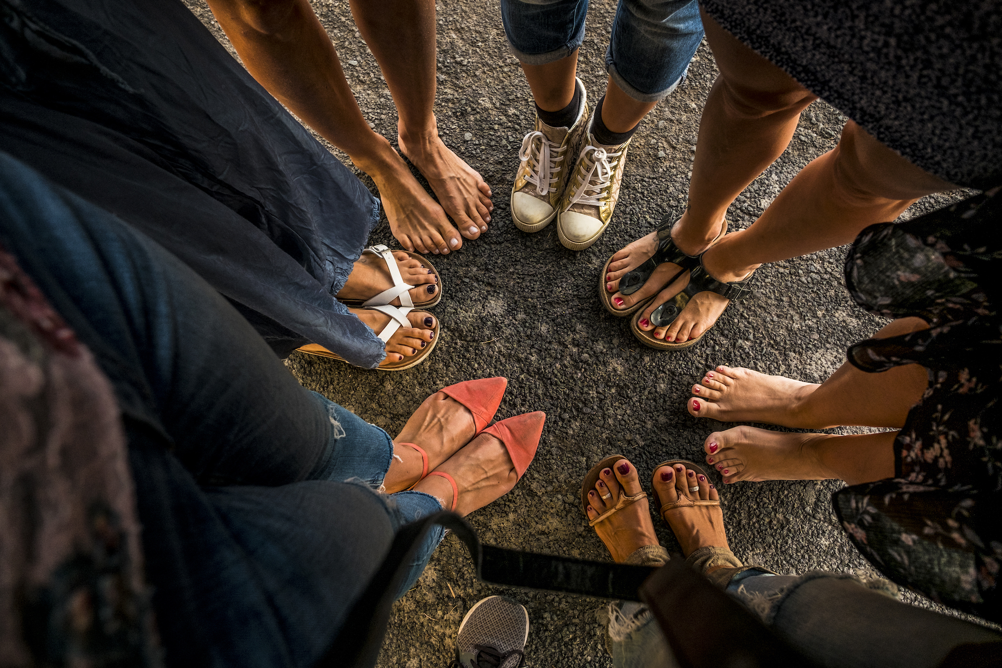 Above, view of caucasian women feet with shoes - spring and summer concept of friendship together outdoor after lockdown quarantine