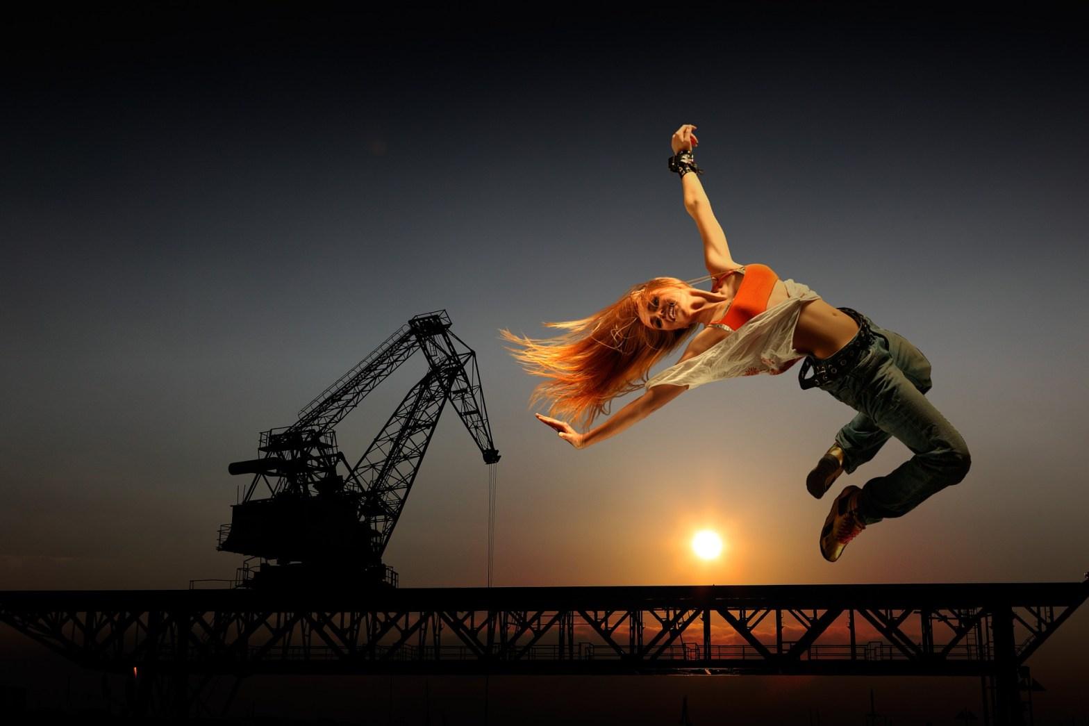 girls in jeans leap - artistic