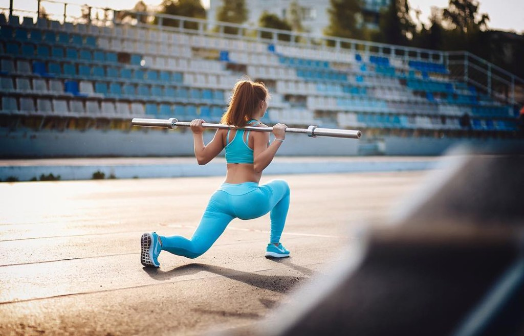 fitness model on the runtrack heavylifting