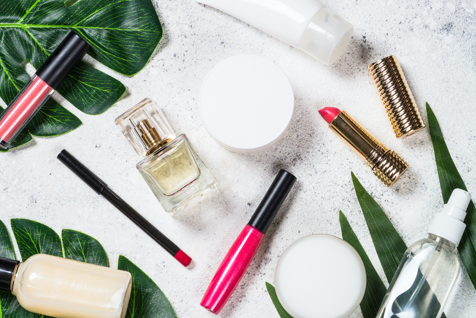 Cosmetic beauty products on white.