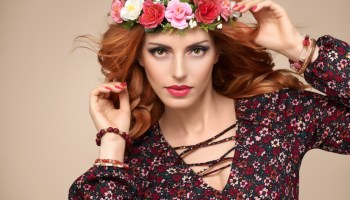 Autumn Fall Fashion Portrait. Redhead Model Woman in Stylish Floral Dress, Flower Hairband. Trendy Curly Hairstyle, Makeup. Fashion autumn Beauty Lady. Glamour Playful Girl, Fall Concept