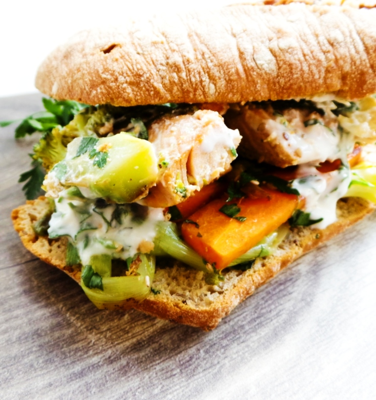 The best salmon sandwich recipe - I love this simple & quick, yet delicious easy salmon dinner recipe! All you need is one pan, salmon, mixed vegetables, some garlic sauce and the bread is optional - you can easily make this salmon recipe gluten-free and paleo!
