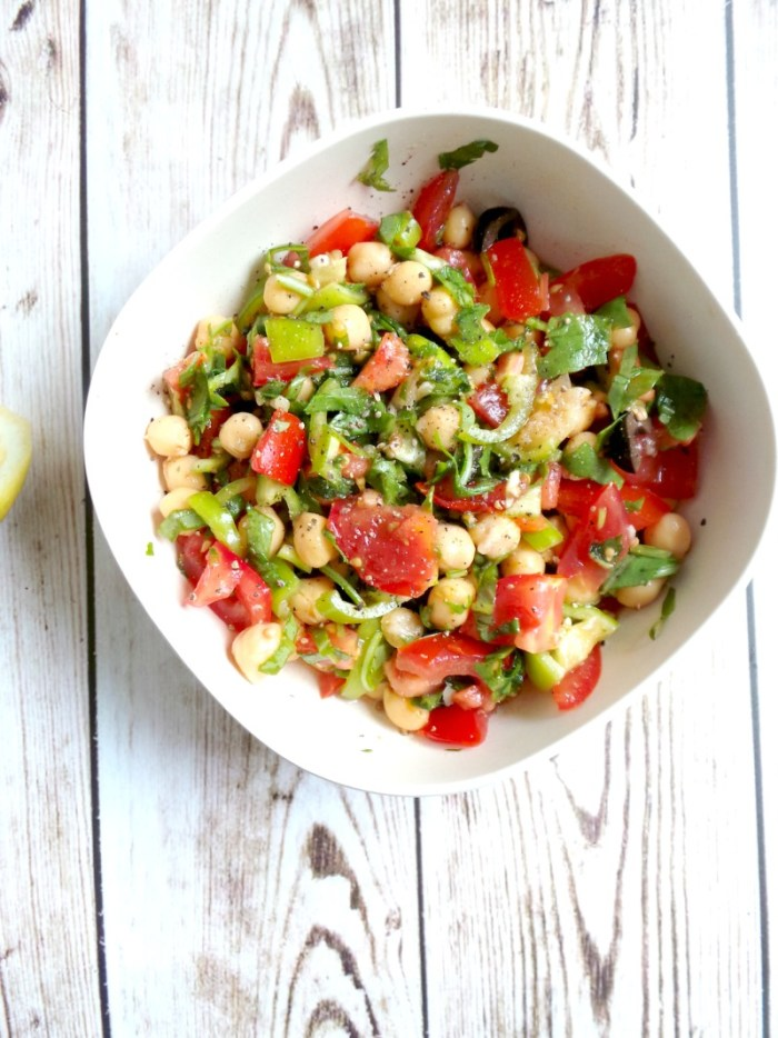 Tomato, Garlic and Chickpea Salad Recipe - Vegan, Gluten-Free. Try this delicious healthy chickpea salad for lunch or dinner! It's high-fiber, great for your health, vegan & gluten-free. Can have it as a side or main dish, this healthy and easy chickpea recipe is suitable for most clean-eating plans, great for weight loss and actually good for healthy skin!