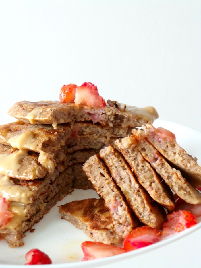 Easy Banana Oatmeal Pancakes - super tasty & healthy pancake recipe! These are really good and easy to make! You need one bowl to mix and one pan to cook. I added strawberry chunks to the batter (can't see them though) & walnuts (so good!). Super delicious, quick, easy, healthy, high-fiber breakfast that isn't oatmeal (well...)! The recipe makes 6 small pancakes, which were the perfect serving size for me | www.beautybites.org