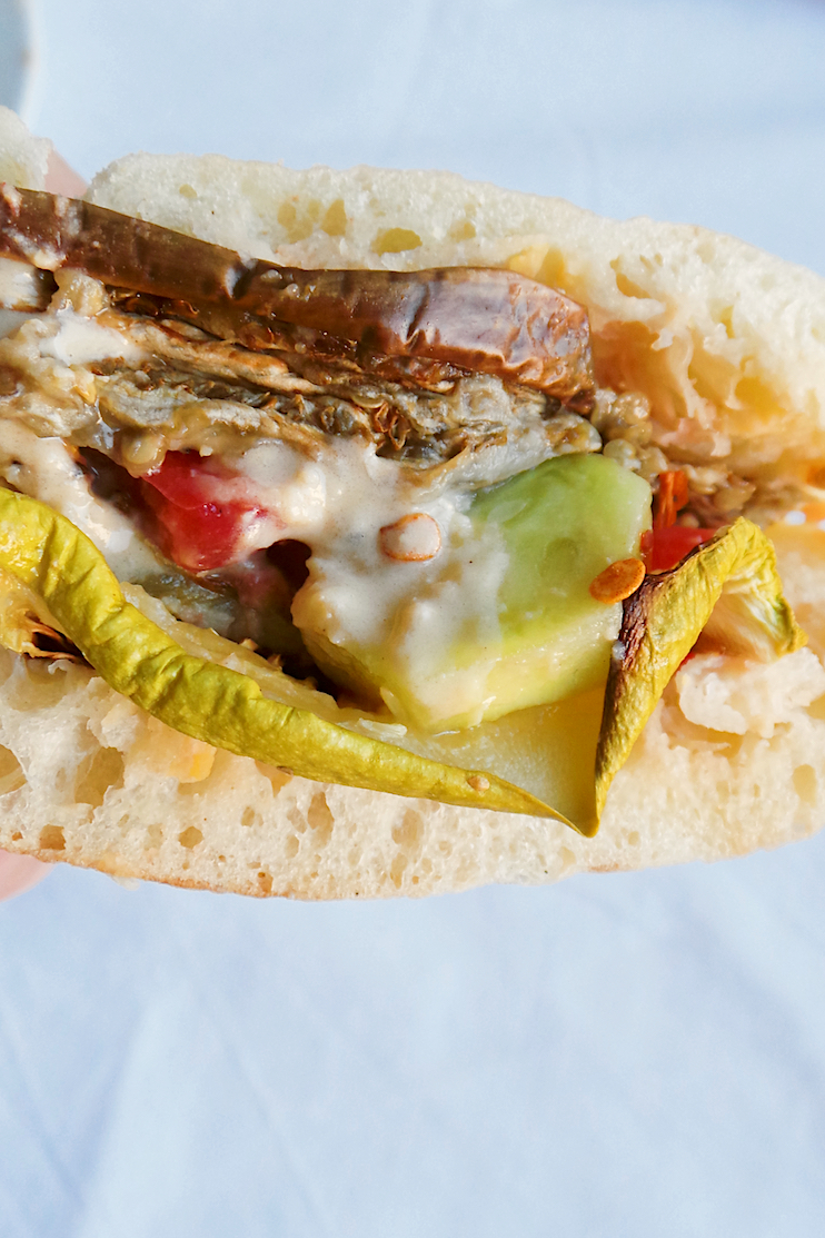 A healthy & easy vegan recipe you need to try - grilled vegetable pita with hummus and tahini sauce! | www.beautybites.org