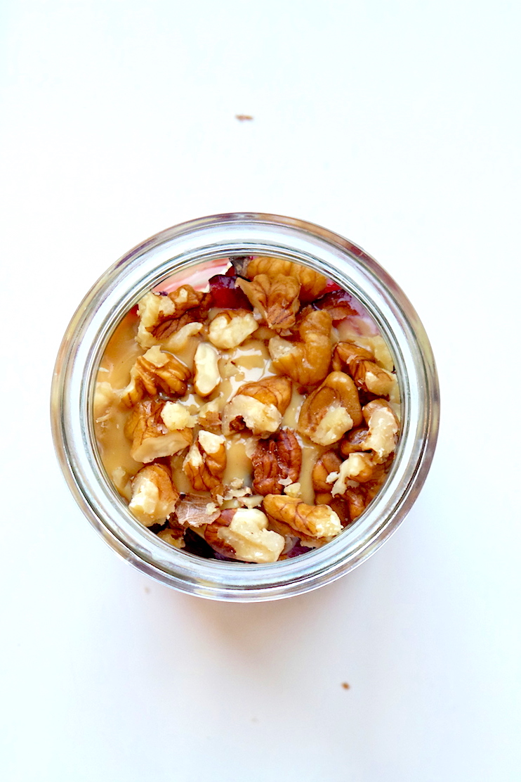 Healthy vegan breakfast recipe - perfect to eat on the go - overnight oats with cherries, banana and nuts! It's quick, nutritious and tastes like dessert!   www.beautybites.org