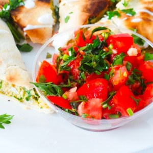 Simple tomato and mint salad with garlic - refreshing and satisfying side dish to use in wraps, bowls or with dinner!