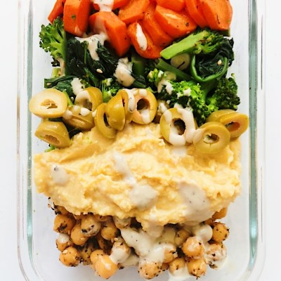 Meal prep chickpea bowl recipe with hummus, greens and, let's be honest, a lot of garlic! A healthy vegan dinner that is filling and full of flavor!