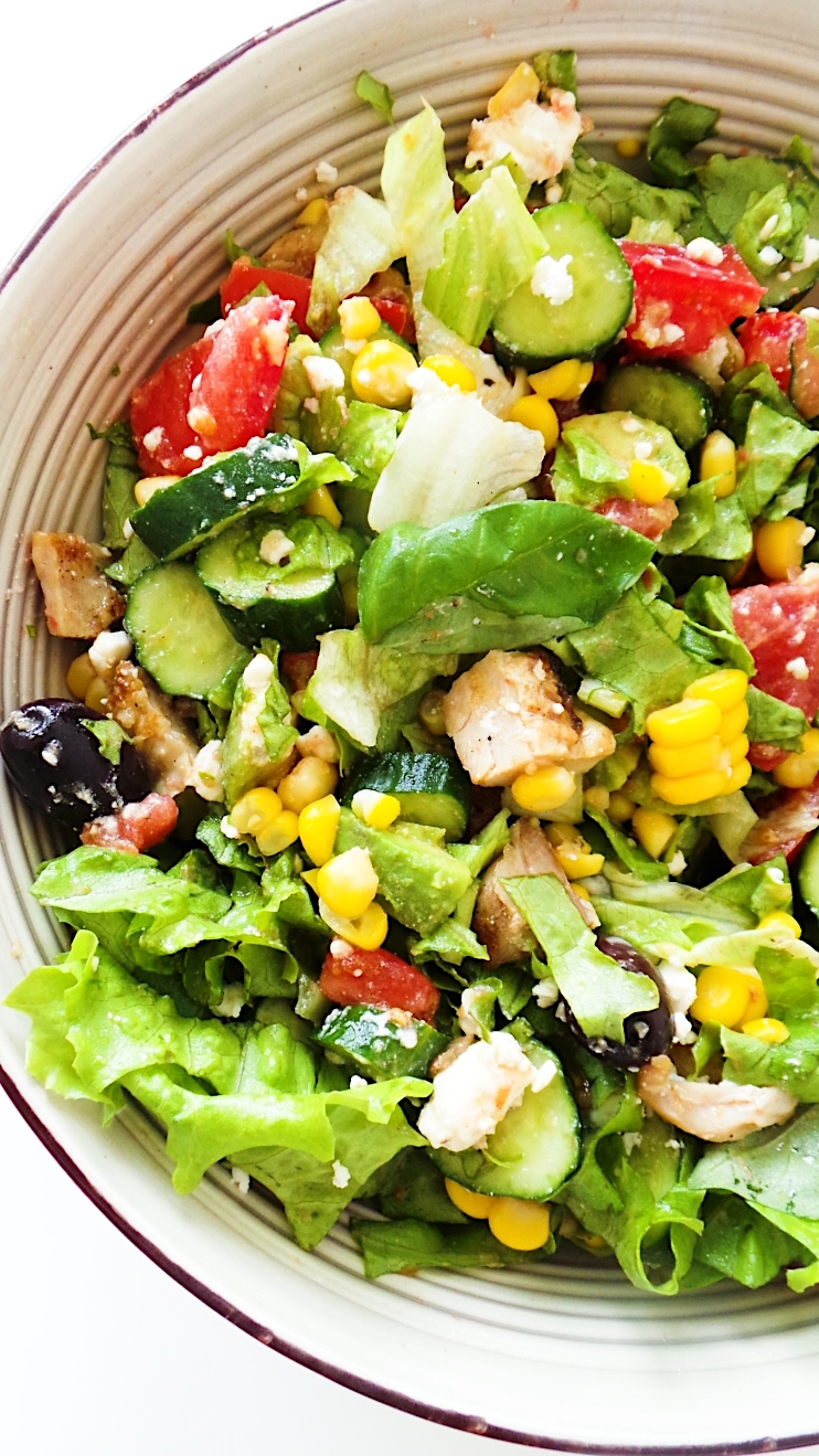 Avocado salad with everything - a fresh, delicious and healthy salad that will fill you up. With avocado, chicken, corn, vegetables, olives and feta this salad is perfect for summer! It's gluten-free, nut-free and can be made ahead with a few magic tricks.