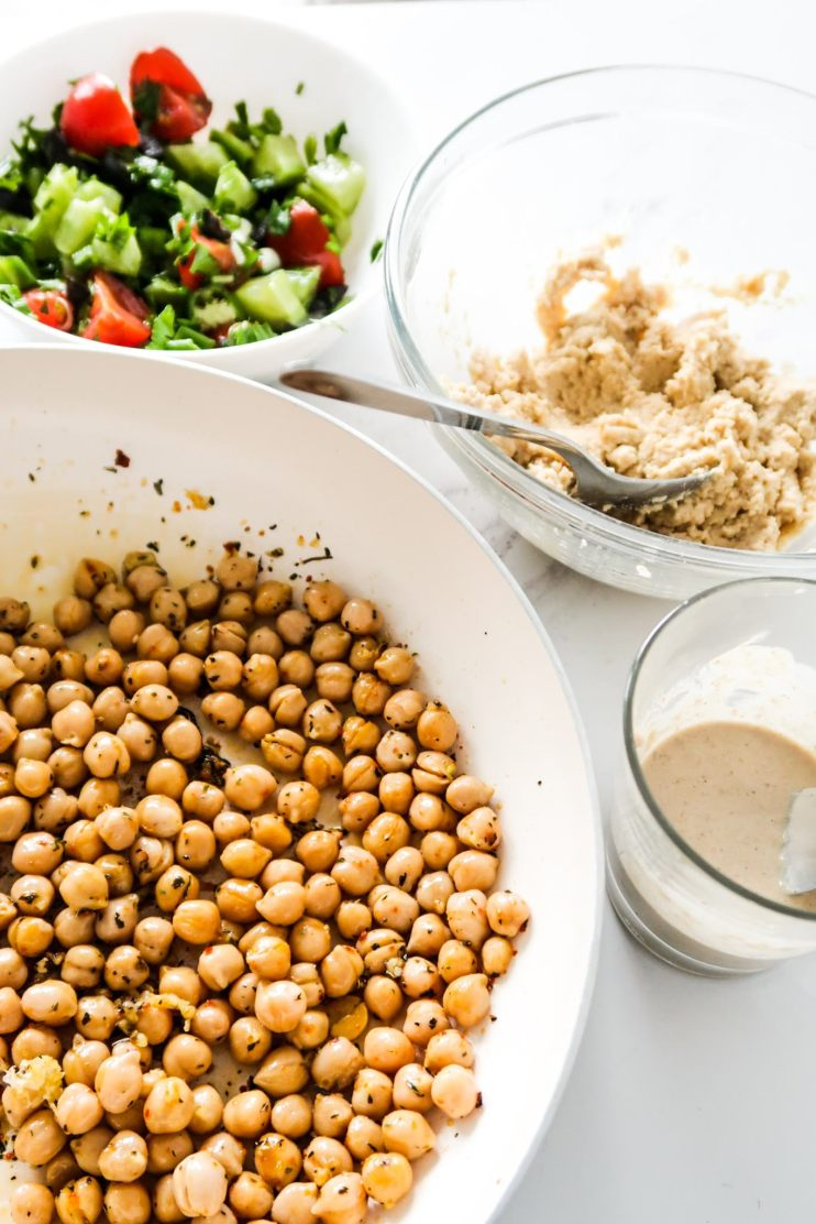 Easy and healthy Mediterranean chickpea wraps! This vegan chickpea recipe is absolutely delicious, quite easy to make with natural whole food ingredients and is great for vegan meal prep. It is my lazy version of falafel and if you love the Mediterranean diet, you'll really love this Mediterranean dinner recipe - it's spicy, fresh and full of flavor.