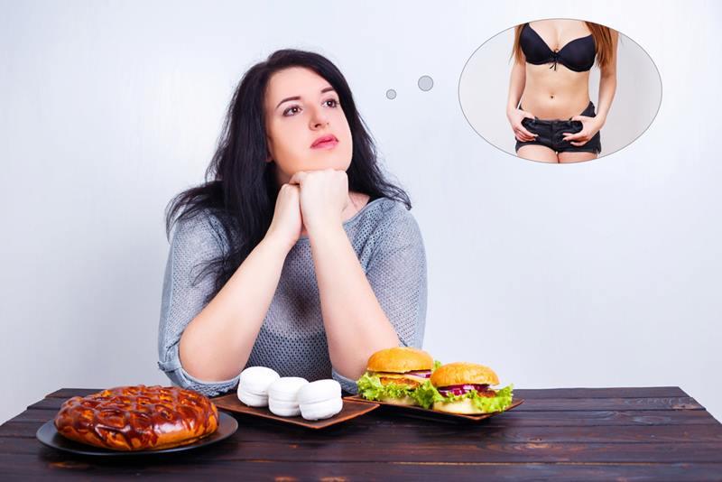 vrouw droomt van slank figuur