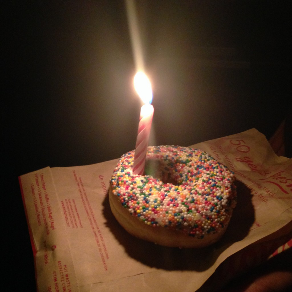 "My impromptu ""birthday cake"" donut, made with a vanilla sprinkle donut we got from Tim Horton's on the way out (we asked for the birthday cake donut but they didn't have any :() and a candle Krisa literally pulled out of her pocket as we got into the car. She proceeded to sing me happy birthday, and the whole thing was really sweet. Thanks again for the great memory, Krisa! :D <3"