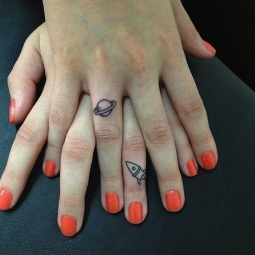 rocket ship planet couple tattoo