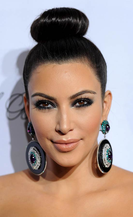 Kim Kardashian with a sleek top knot hairstyle