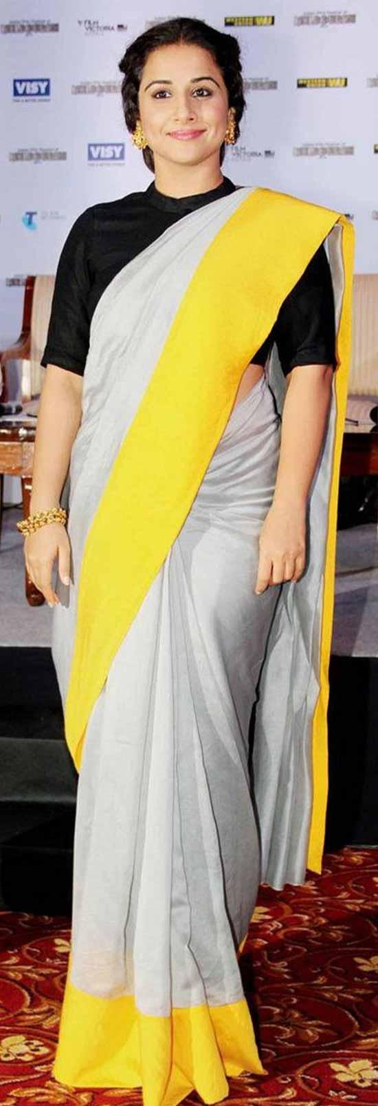 Vidya-Balan-Plane-Cream-Saree-And-Yellow-Boeder-With-Black-Blouse