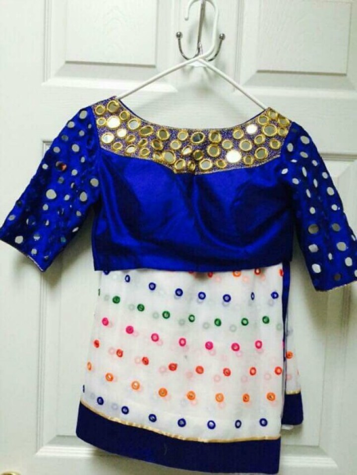 White Saree With Multicolor Mirror Work Along With Royal Blue Boat Neck Blouse