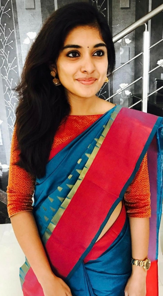 Niveda Thomas In Blue Saree Paired With Boat Neck Blouse