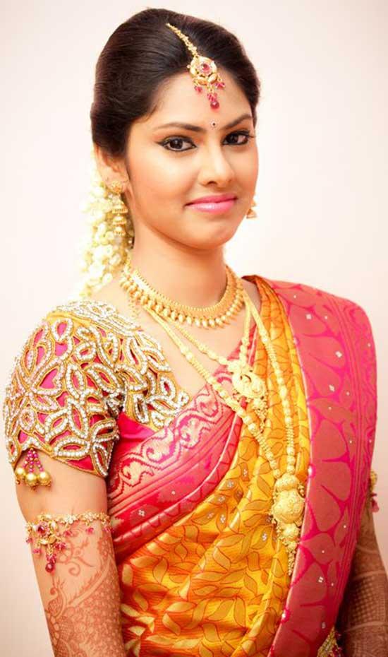 Yellow saree with elegant cut work pink blouse