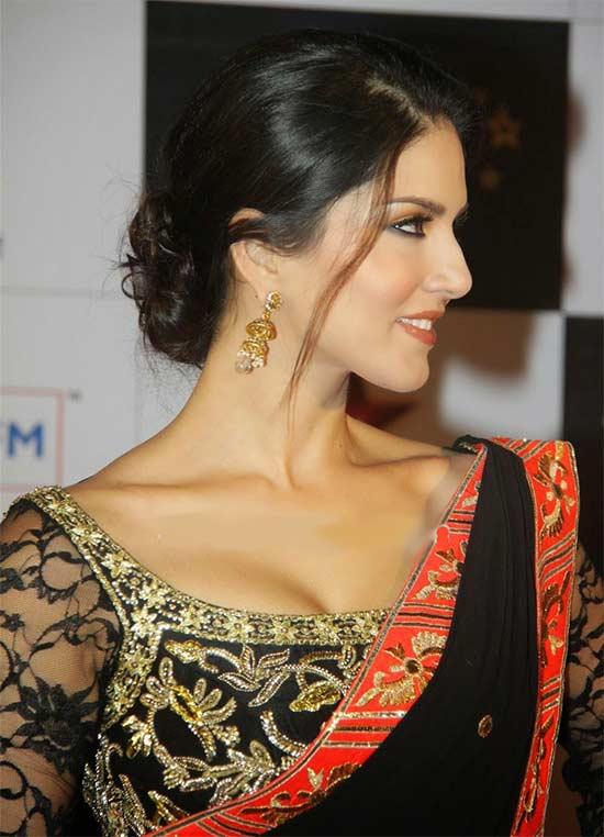 Sunny Leone wearing black saree with gorgous deep neckline blouse