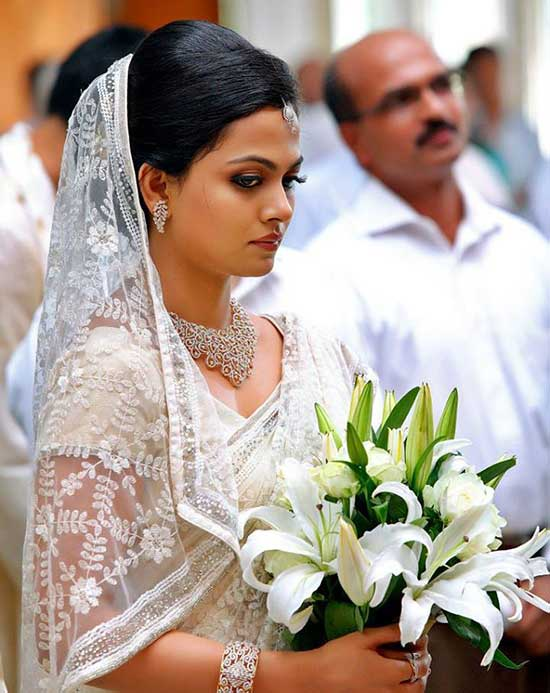 christian bride in jewellery with white saree