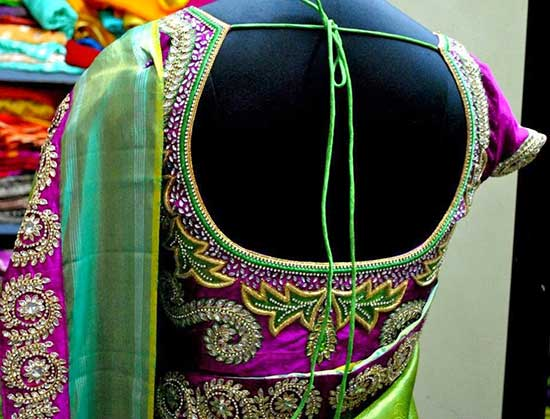 Purple And Green Heavy Embroidery Cutting Maggam Blouse Design