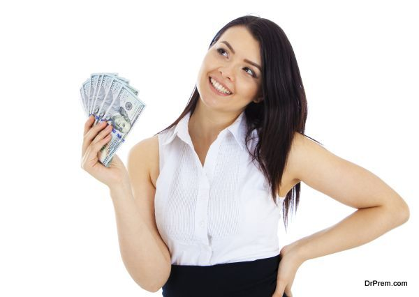 Dreaming business woman with cash in hand