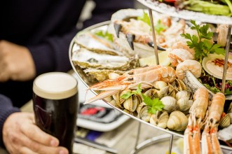 Group of friends having a seafood platter outside of Johnnie Fox's pub, Dublin