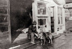 23 Man and Dog in front of Thyngs Confectionary in 1916