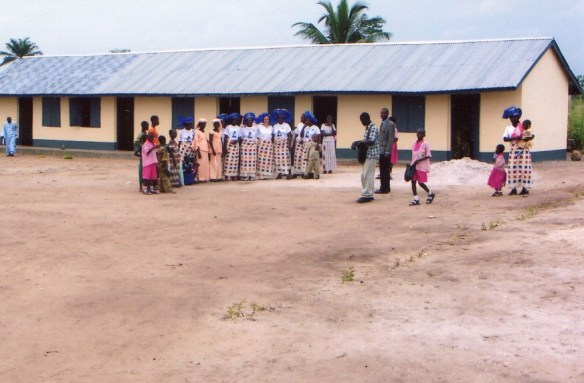 Members of the Tijen Pegg Mothers' Association pose for a photograph in front of our newly opened classroom building in Bane in June 2004.