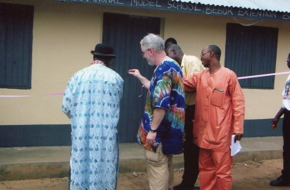 Scott Pegg and the late paramount ruler of Bane ceremonially cutting the ribbon to open our first classroom building there in June 2004.