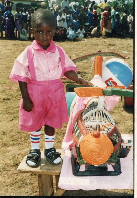 Baridule Kinane, a Bodo student, with a locally made helicopter toy in 2001.