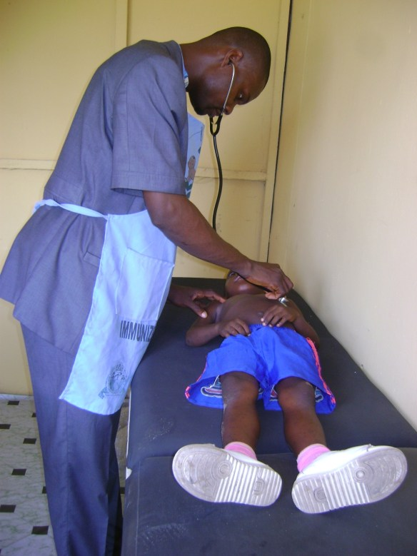 Dr. Nubari Nabie, the health project coordinator, examining one of our pupils in March 2013.