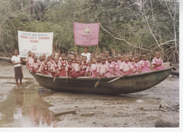 Students from our school in Bodo posing for a picture in a local fishing boat in 2003.  You can again see the lush green mangrove trees in the background of this photo.